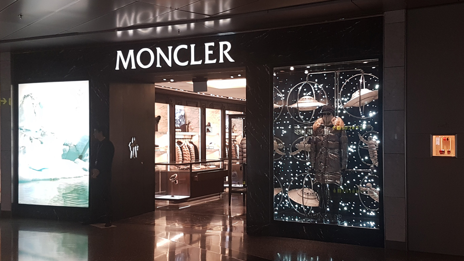 Moncler Spaceman Window at Hamad International Airport - fabricated and installed by ME Visual, Qatar