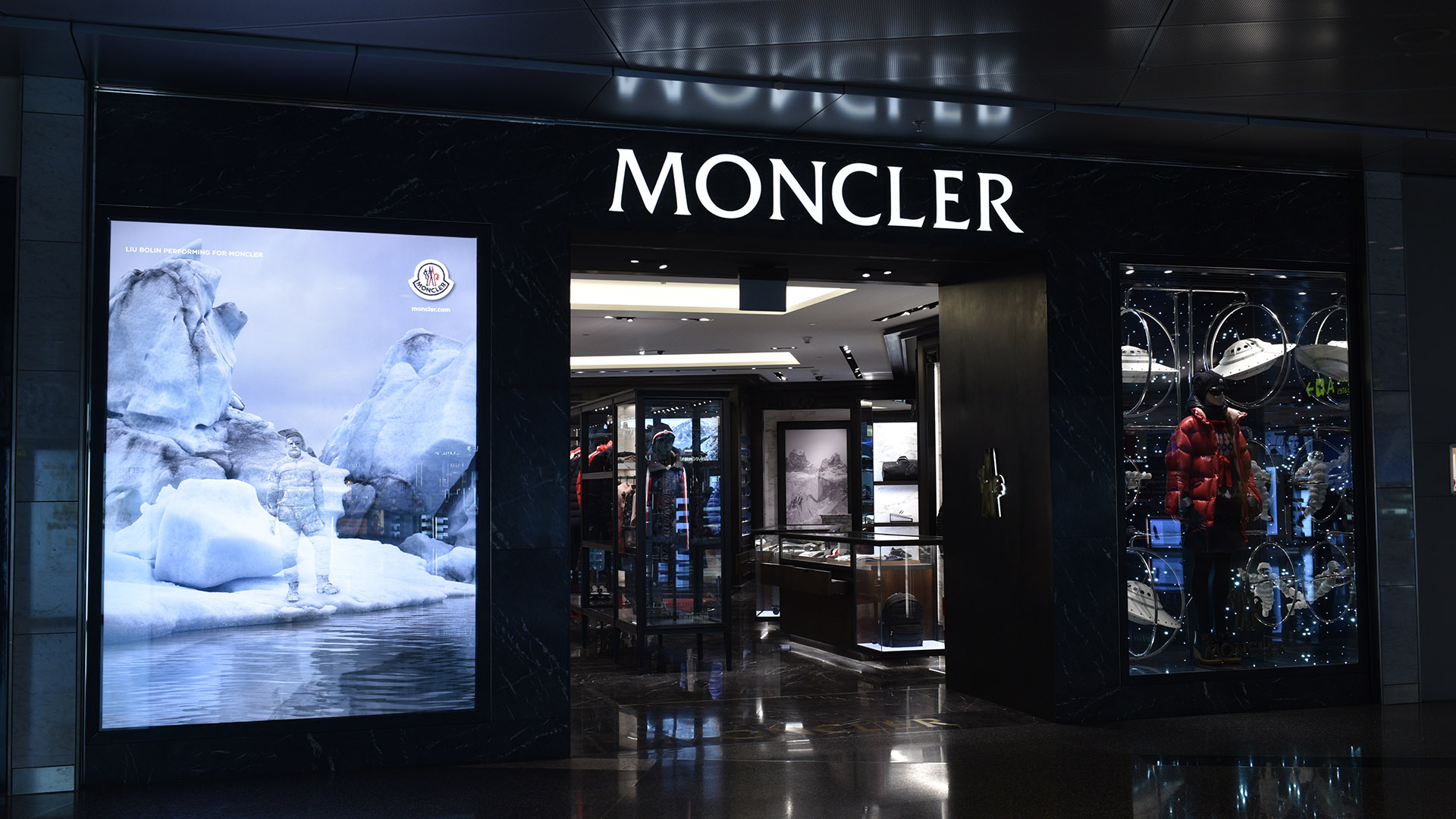 Moncler Spaceman Window at Hamad International Airport - fabricated and installed by ME Visual, Qatar. This display uses Fiber-optic lights.