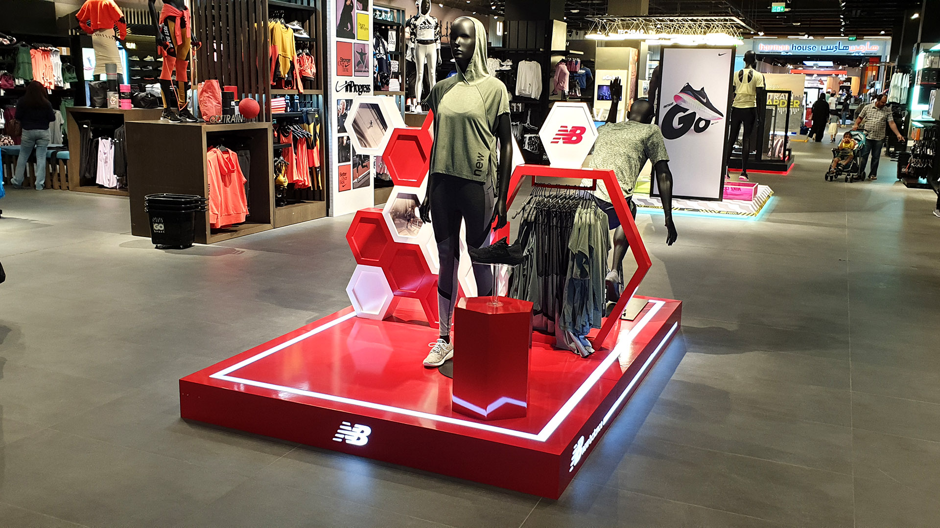New Balance retail display stand fabricated and installed by ME Visual at Go Sport stores across Qatar.